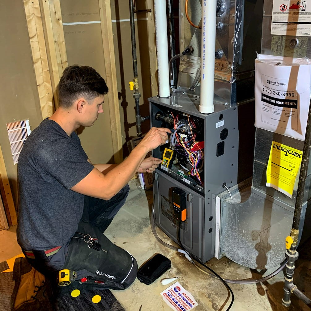 north wind hvac technician making furnace repair