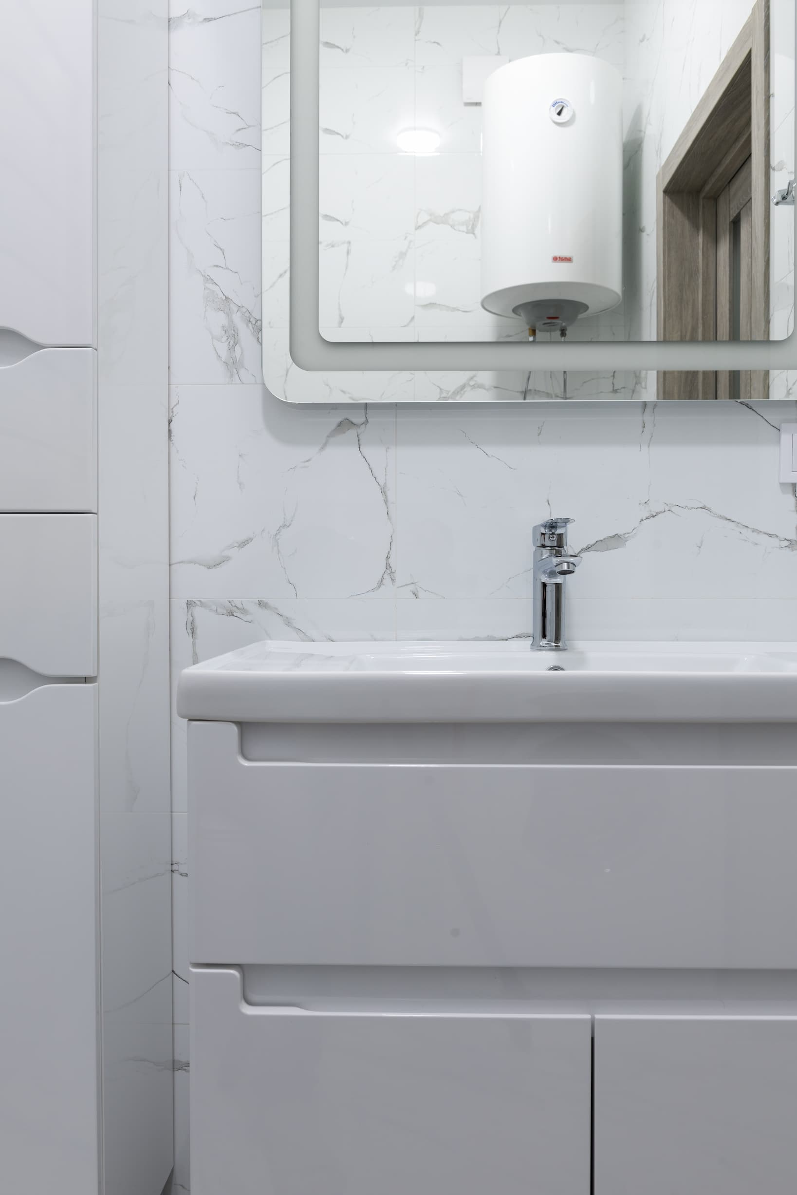 White hot water tank shown in the mirror reflection